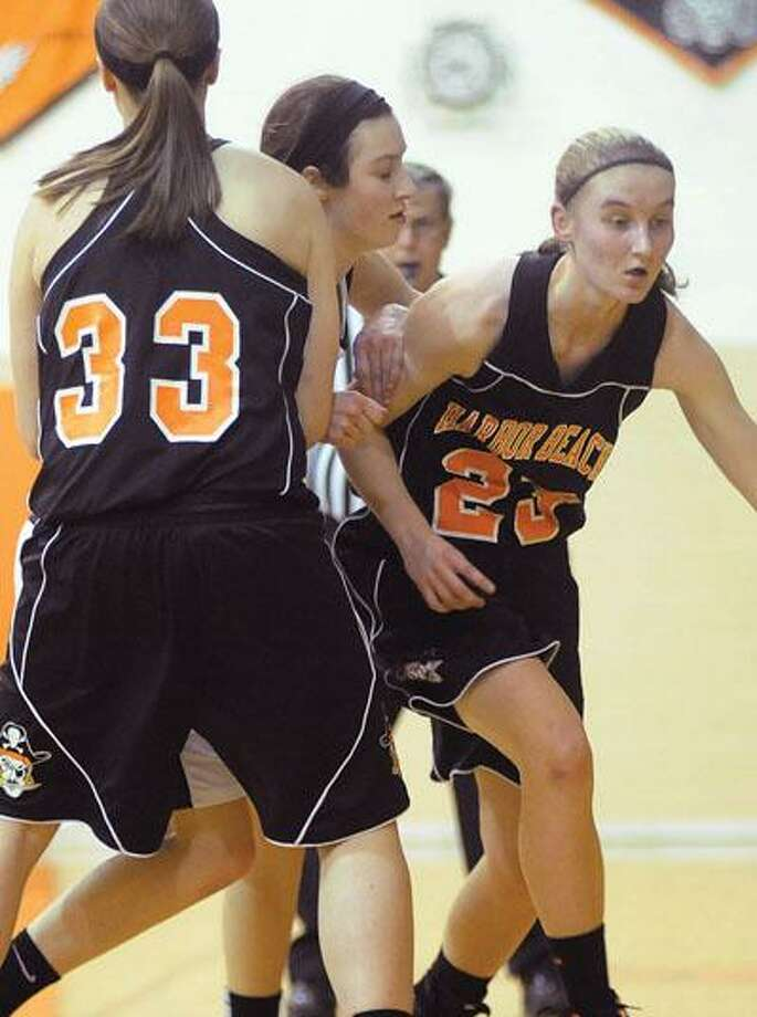 Harbor Beach's McKenna Wolschleger (33) sets a pick for teammate Emily Pawlowski (23) in the first half.