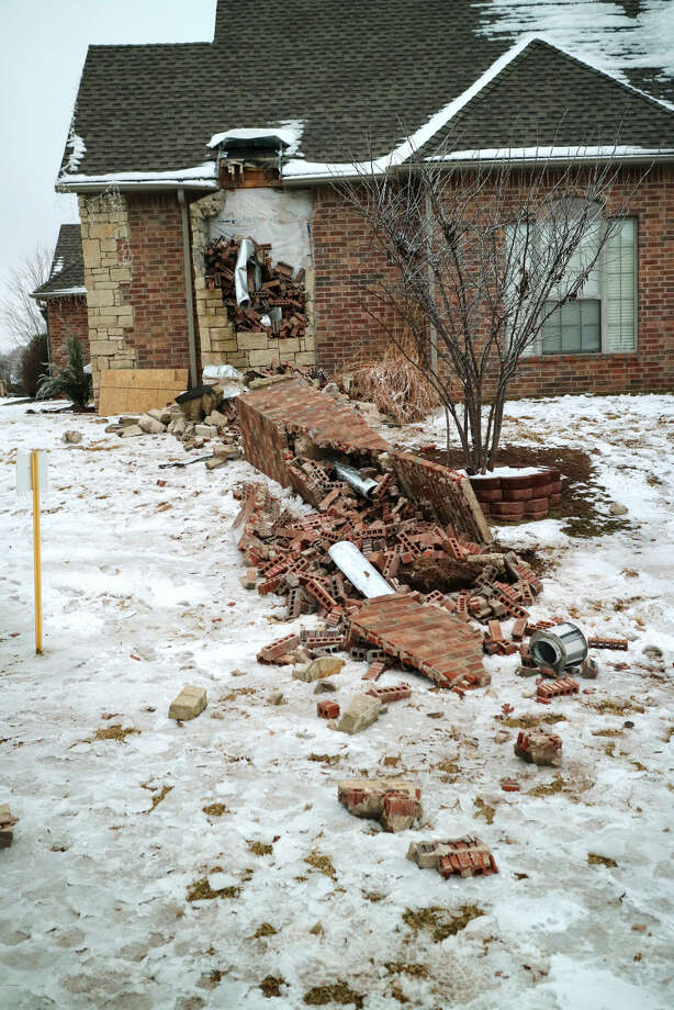 In this Dec. 29, 2015 photo, remains of a collapsed chimney rest on the ground outside a home in Edmond, Okla., following an earthquake. In Oklahoma the stronger and more frequent earthquakes have people worrying about the big one. In Oklahoma, now the country's earthquake capital, people are talking nervously about the big one as man-made quakes get stronger, more frequent and closer to major population centers. (Doug Hoke/The Oklahoman via AP) LOCAL STATIONS OUT (KFOR, KOCO, KWTV, KOKH, KAUT OUT); LOCAL WEBSITES OUT; LOCAL PRINT OUT (EDMOND SUN OUT, OKLAHOMA GAZETTE OUT) TABLOIDS OUT; MANDATORY CREDIT Photo: Doug Hoke