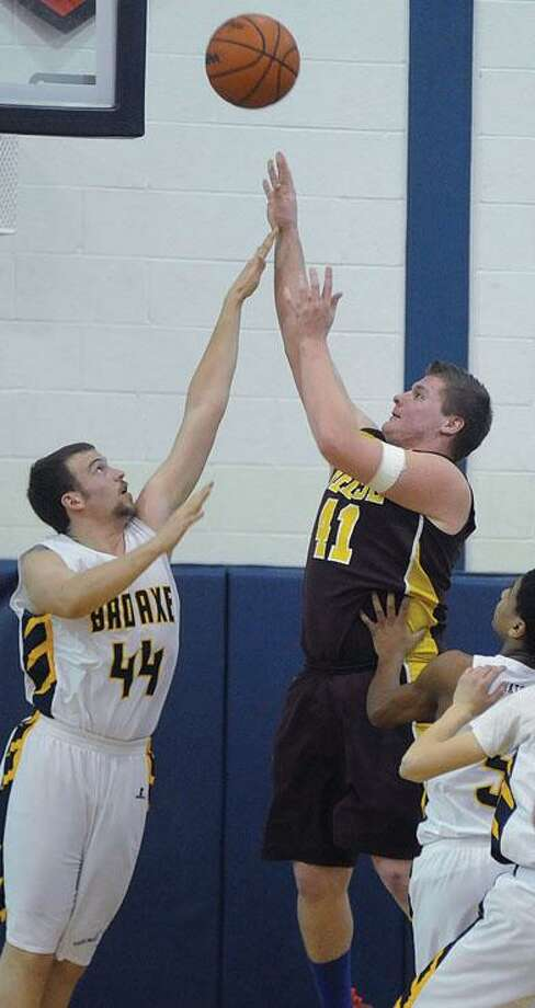 Bad Axe's Ben Sutton (44) attempts to block the shot of Reese's Archie Naert (41) in the first half.