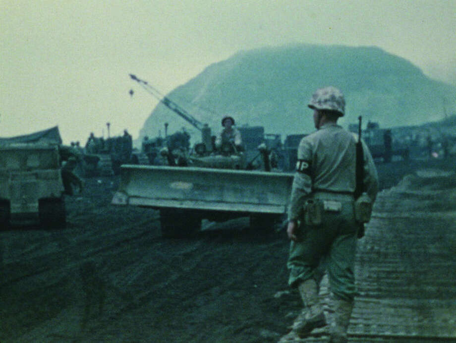 This photo provided by the University of South Carolina shows a scene from the Battle of Iwo Jima, recorded by the U.S. Marine Corps in 1945, is part of a collection of silent, color films being preserved by the Moving Image Research Collections at the University of South Carolina in Columbia, S.C.