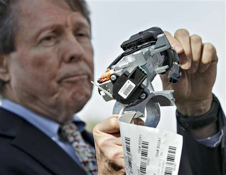 In this April 1, 2014, file photo, Clarence Ditlow, executive director of the Center for Auto Safety, displays a GM ignition switch similar to those linked to 13 deaths and dozens of crashes of General Motors small cars like the Chevy Cobalt, during a news conference on Capitol Hill in Washington. A civil trial starting January 2016 in New York City will test the legal boundaries of hundreds of claims remaining against General Motors over faulty ignition switches. (AP Photo/J. Scott Applewhite)