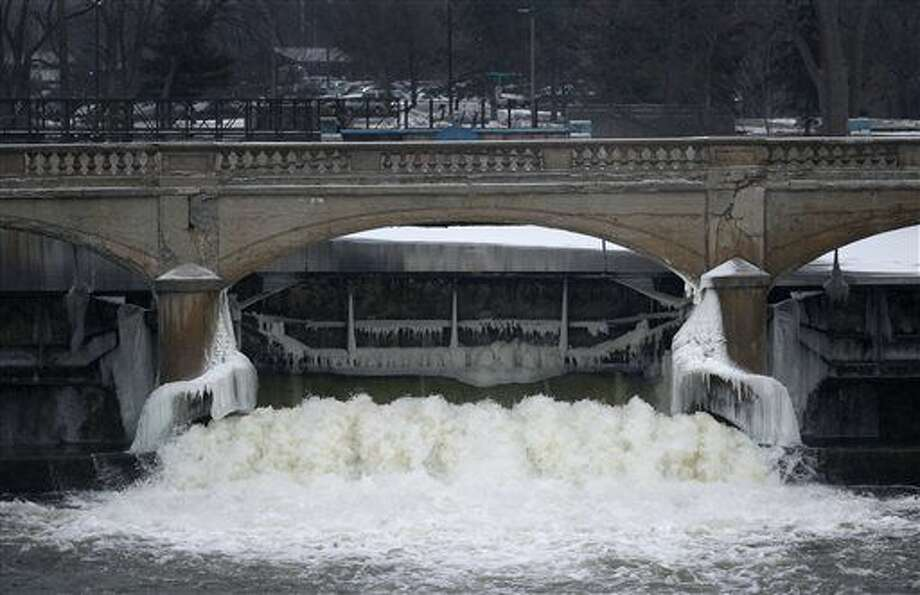 The Flint River is shown near downtown Flint, Mich., Thursday, Jan. 21, 2016. Residents in the former auto-making hub — a poor, largely minority city — feel their complaints about lead-tainted water flowing through their taps have been slighted by the government or ignored altogether. For many, it echoes the lackluster federal response to New Orleans during Hurricane Katrina in 2005. (AP Photo/Paul Sancya)