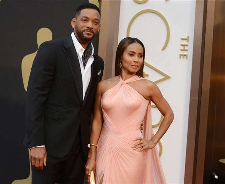 In this March 2, 2014, file photo, Will Smith, left, and Jada Pinkett Smith arrive at the Oscars at the Dolby Theatre in Los Angeles. Smith said Thursday, Jan. 21, 2016, he will not attend the Academy Awards next month, joining his wife, Jada Pinkett Smith, and others in protest against two straight years of all-white acting nominees. (Photo by Jordan Strauss/Invision/AP)