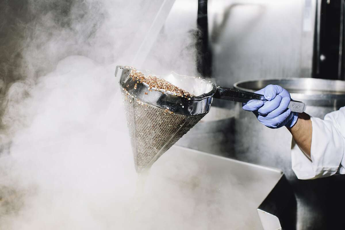 A worker removes cooked quinoa from a tilt skillet at Munchery's kitchen in San Francisco, Calif. on Tuesday, April 19, 2016.