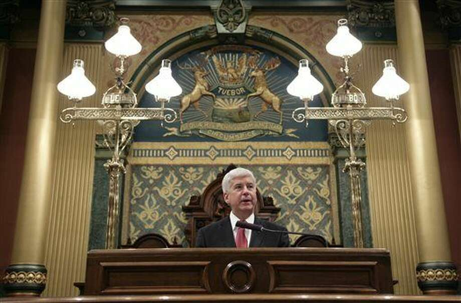 Michigan Gov. Rick Snyder delivers his State of the State address to a joint session of the House and Senate, Tuesday, Jan. 19, 2016, at the state Capitol in Lansing. (AP Photo/Al Goldis)