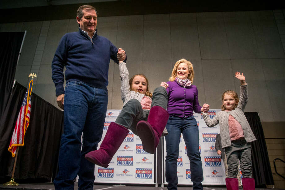 Republican presidential candidate Sen. Ted Cruz, R-Texas, and his wife Heidi swing their daughter Caroline, 7, as their younger daughter Catherine, 4, right, waves to members of the audience after Cruz spoke at a rally at the Five Sullivan Brothers Convention Center in Waterloo, Iowa, Saturday, Jan. 23, 2016. (AP Photo/Andrew Harnik) Photo: Andrew Harnik