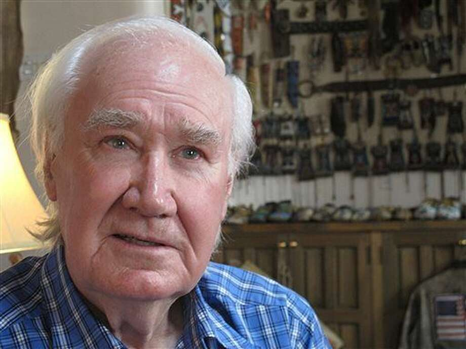 In this March 22, 2013 file photo, Forrest Fenn sits in his home in Santa Fe, N.M. Geese, a few bald eagles and the majesty that is northern New Mexico's landscape. That's all Fenn has spotted as he flies in a chartered helicopter over remote stretches of the Rio Grande, looking for any sign of, Randy Bilyeu a Colorado man who went missing while searching for his hidden treasure. (AP Photo/Jeri Clausing)