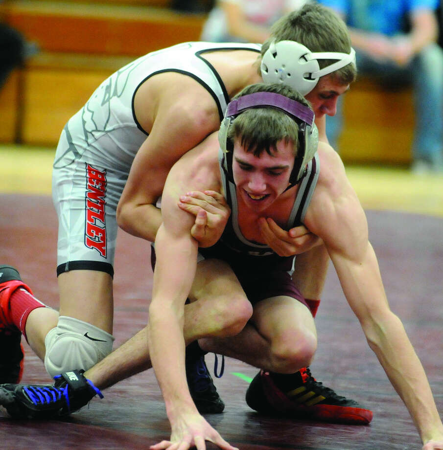 Cass City wrestler Tyler Hool competes at the Division 4 team regional, last week in Mayville. Hool was born with a genetic disorder that makes it difficult to walk. But he hasn't let that stop him from being an important part of the team.