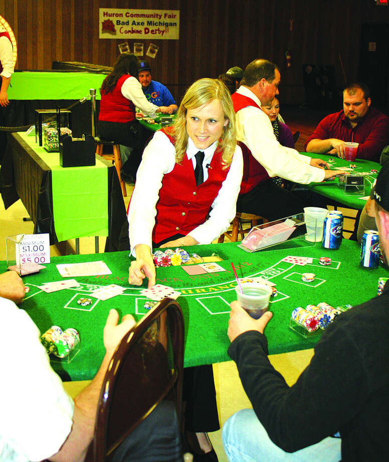 Deanna Wruble deals during Saturday's Casino Night to benefit the Huron Community Fair Association. Photo: Rich Harp/For The Tribune