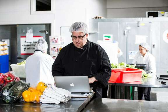 Steven Levine, resident chef at Munchery, works on his computer at the company's kitchen in San Francisco, Calif. on Tuesday, April 19, 2016.
