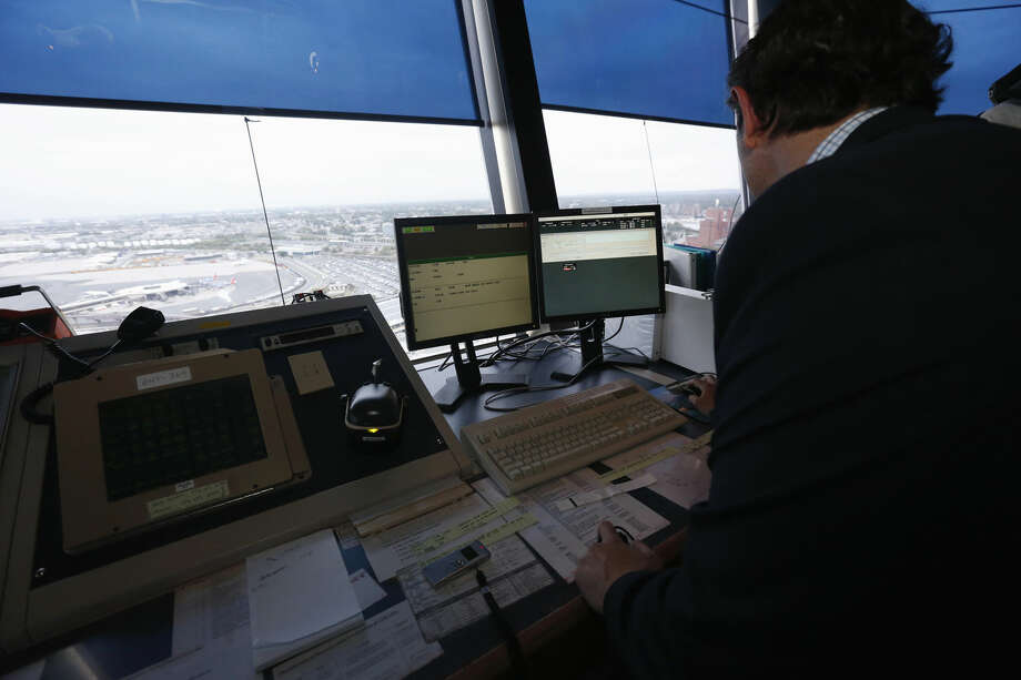 FILE - In this May 21, 2015 file photo, the Newark Liberty International Airport the air traffic control tower in Newark, N.J. A government watchdog says there are too few fully qualified controllers at more than a dozen air traffic facilities stretching from Atlanta to Anchorage. A report released Tuesday, Jan. 26, 2016, by the Transportation Department's inspector general says the 13 airport towers, approach control facilities and en route centers have fewer fully trained controllers than the minimum number established by the Federal Aviation Administration. (AP Photo/Julio Cortez, File) Photo: Julio Cortez