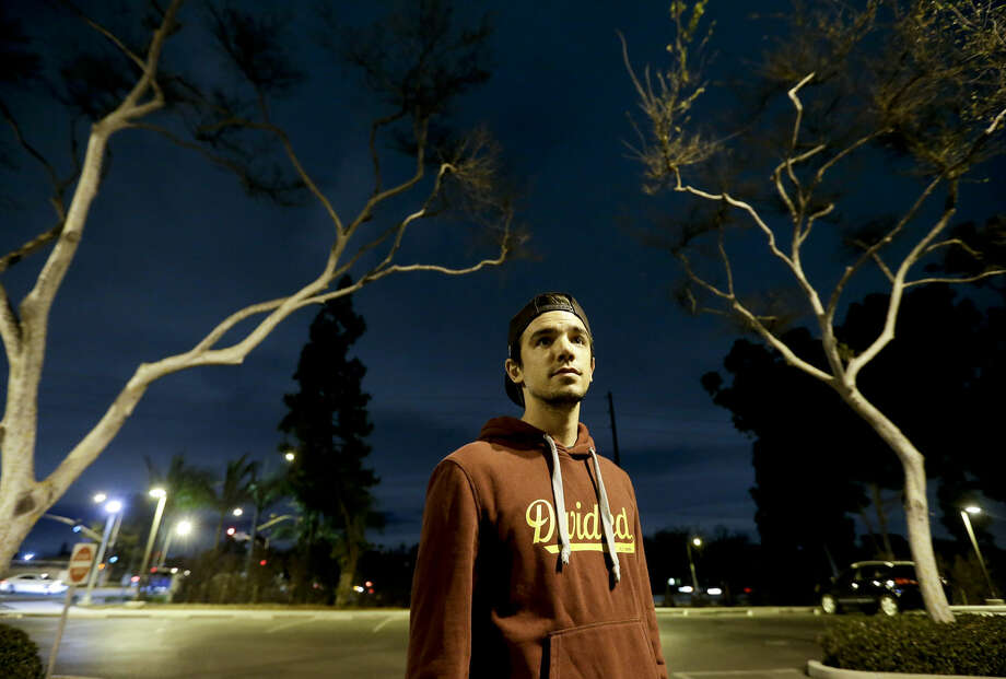 """In this photo taken Jan. 19, 2016, college student Christopher Rael poses for a picture at California State University, Long Beach, in Long Beach, Calif. Millions of young adults healthy enough to think they don't need insurance face painful choices this year as sign-up deadline approaches for President Barack Obama's health care law. With open enrollment over after Jan. 31, Rael is hoping his meager income will qualify him for Medi-Cal, the state's version of Medicaid. """"I cannot afford an additional bill,"""" he said. He paid a fine of about $150 for being uninsured in 2014. (AP Photo/Chris Carlson) Photo: Chris Carlson"""