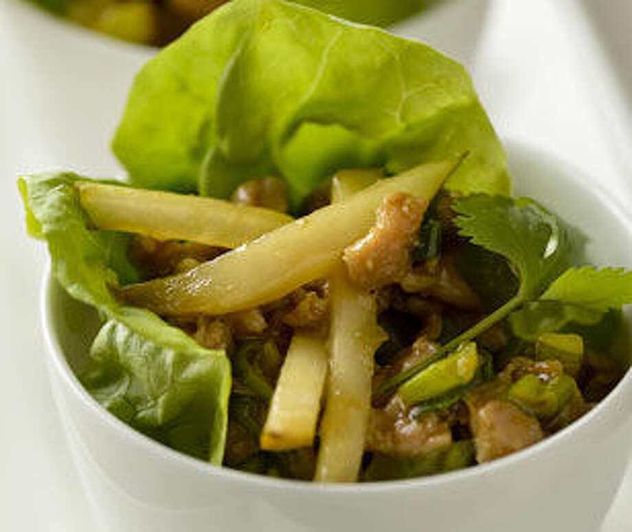 Fresh crisp pears give these savory chicken lettuce wraps a sweet flavor and crunch.
