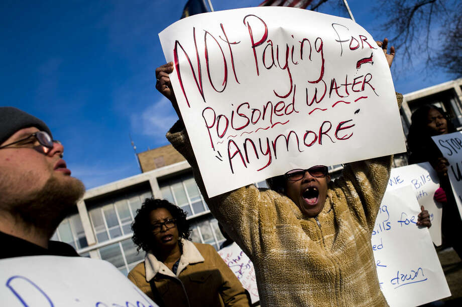 Flint resident Angela Hickmon, 56, chants during a protest outside City Hall in downtown Flint, Mich., Monday, Jan. 25, 2016. Michigan's attorney general named a former prosecutor on Monday to spearhead an investigation into the process that left Flint's drinking water tainted with lead, though Democrats questioned whether the special counsel would be impartial. (Jake May/The Flint Journal-MLive.com via AP) Photo: Jake May
