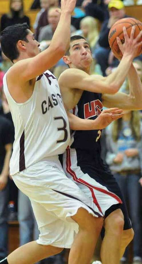 USA's Nick DeSimpelare drives against Cass City's Tristan Kuntz (30) in the first half of the Patriots' 62-51 Class C district quarterfinal win, Monday night in Cass City.