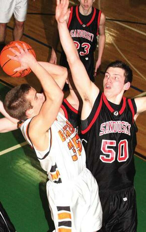 Harbor Beach's Colin Cook (35) goes the basket against Sandusky's Okie (50) in the second half.