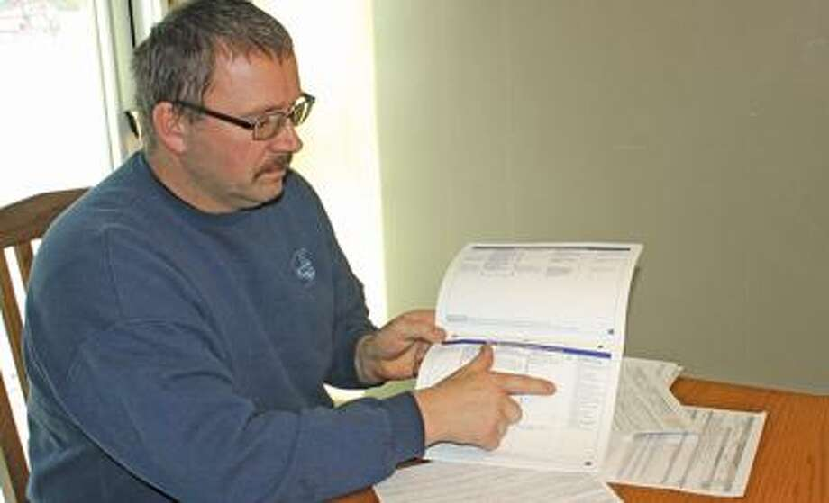 Brian Pawlowski looks over some of his conservation program practices.
