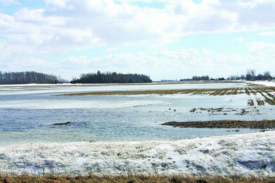 Seth Stapleton/Huron Daily Tribune A sign of spring Water, snow and ice fill much of a farm field late last week a few miles north of Bad Axe. Flooded farm fields can be seen in many parts of the Thumb as winter gradually melts away.