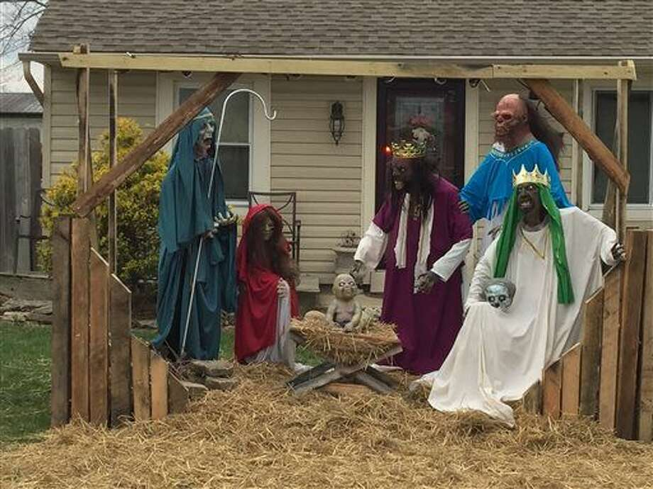 This Dec. 4, 2015, photo shows the accessory structure housing the zombie nativity scene in Rossmoyne, Ohio. According to The Cincinnati Enquirer, the creator of the zombie nativity set, Jasen Dixon, was officially cited Dec. 3 for his accessory structure on the front lawn of his home. The roof of the structure was removed Dec. 4, bringing it into compliance with zoning regulations. (Sheila Vilvens/The Cincinnati Enquirer via AP) Photo: Sheila Vilvens