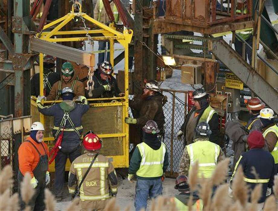 The fourth group of workers emerge from an elevator Thursday, Jan. 7, 2016, after they were stuck overnight in a shaft at the Cayuga Salt Mine in Lansing, N.Y. Cargill Inc. spokesman Mark Klein said all 17 miners have been rescued. (Simon Wheeler/The Ithaca Journal via AP)