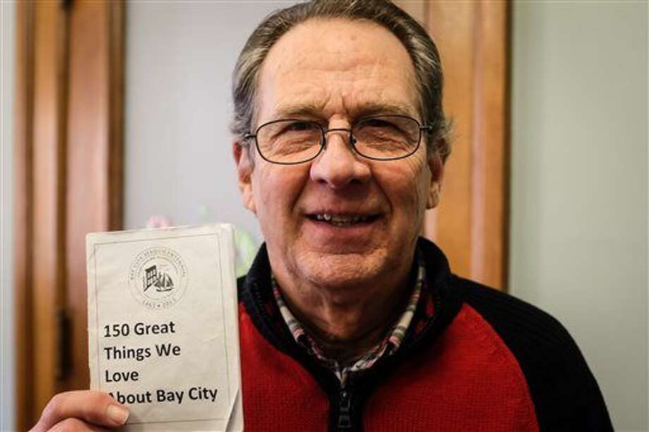 """Contest winner Taylor Langstaff poses in Bay City on Thursday, Jan. 7, 2016. Langstaff won prizes worth nearly $2,000 after being the only person to enter a contest to celebrate a Bay City's 150th anniversary. Langstaff had to do 25 activities in the Bay City area and stamp them off on a """"passport"""" to win the prizes, MLive.com reported. He was the only person to submit a fully-stamped passport. (Andrew Dodson /The Bay City Times via AP)"""
