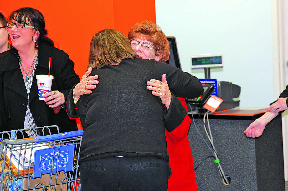 Margaret Bouvrette hugs a well wisher during her retirement celebration Wednesday afternoon. Photo: Seth Stapleton/Huron Daily Tribune