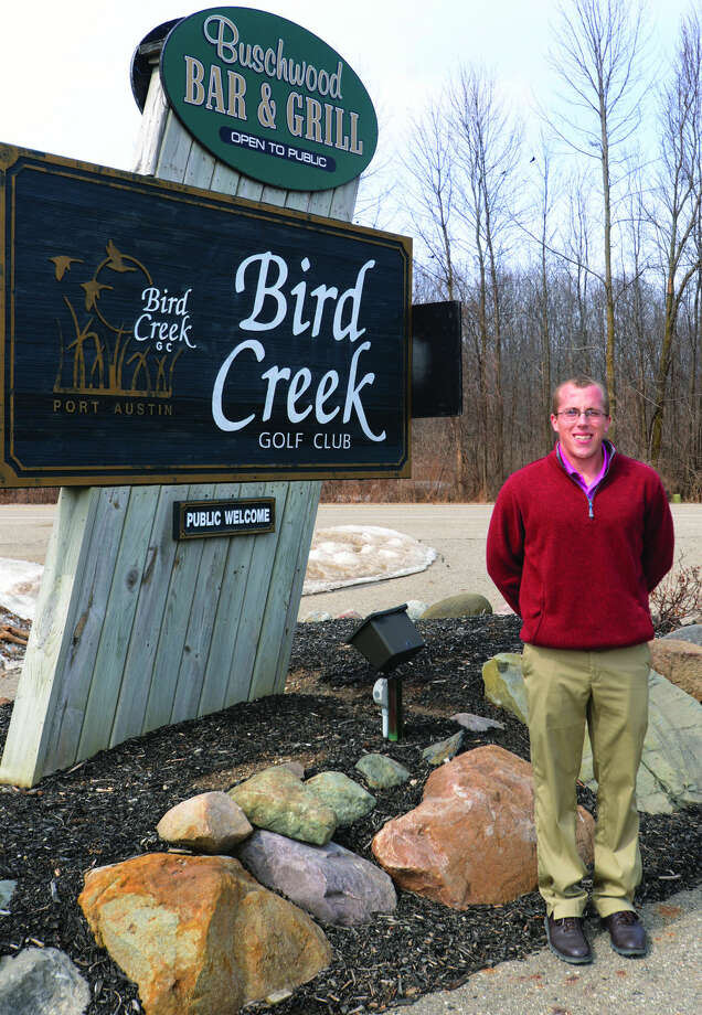 Trenton Donakowski stands near the entrance of Bird Creek Golf Club. The 24-year-old native of Alpena recently took over duties as the club's new PGA Professional and Club House Manager.