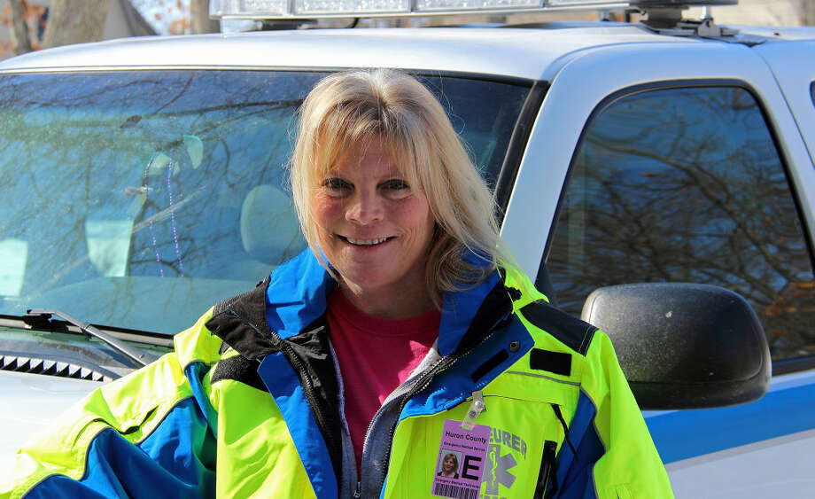 Rhonda Denhoff of Sand Point stands beside the Scheurer Hospital First Responder unit, ready to get a call. Photo: Bill Diller/For The Tribune