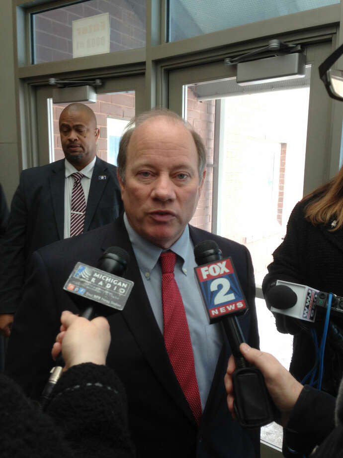 Detroit Mayor Mike Duggan speaks to reporters after visiting a handful of schools Tuesday, Jan. 12, 2016, in Detroit. He said teachers have legitimate concerns about maintenance and building conditions. A sick-out by Detroit teachers closed more than 20 schools Tuesday. (AP Photo/Ed White) Photo: Ed White