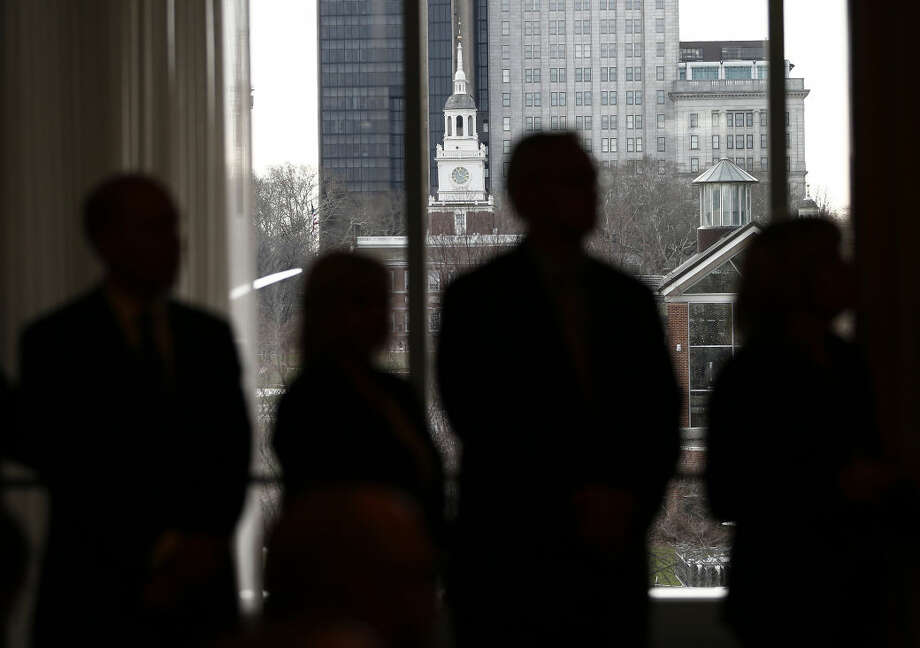 "Members of the media are silhouetted in front of Independence Hall as H.F. ""Gerry"" Lenfest, owner and Chairman of Philadelphia Media Network (PMN), makes an announcement during a press conference at the National Constitution Center in Philadelphia, Pa., Tuesday Jan. 12, 2016. Lenfest announced that he will be donating PMN, the holding company for The Philadelphia Inquirer, Daily News and philly.com to a newly created nonprofit media institute. (AP Photo/Rich Schultz) Photo: Rich Schultz"