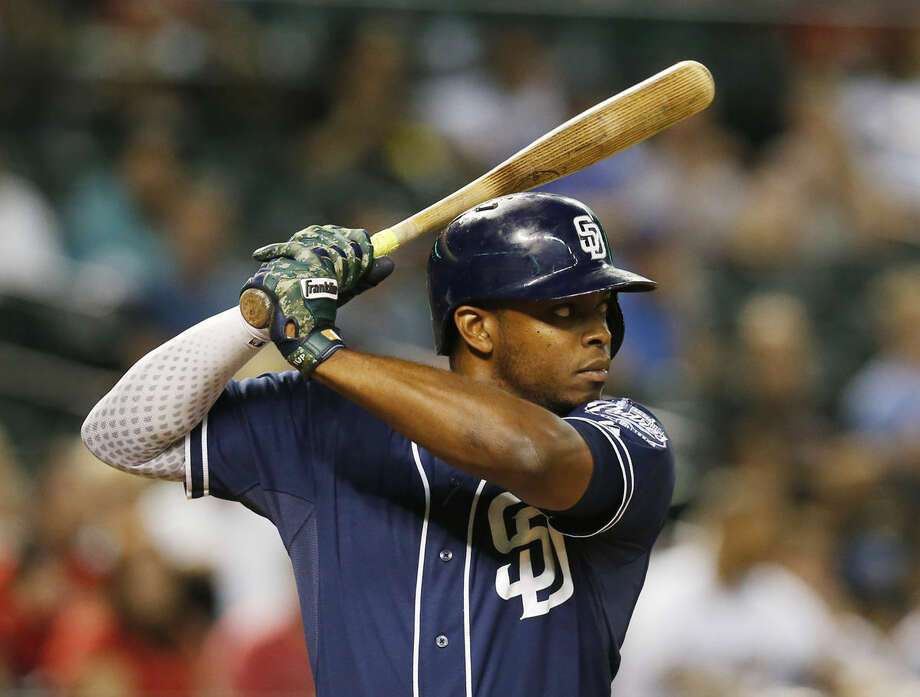 FILE- In this Sept. 15, 2015, file photo, San Diego Padres left fielder Justin Upton looks to hit in the sixth inning of a baseball game against the Arizona Diamondbacks in Phoenix. The Detroit Tigers have agreed to a six-year contract with free-agent outfielder Upton for six years and $132.75 million. (AP)  Photo: Rick Scuteri