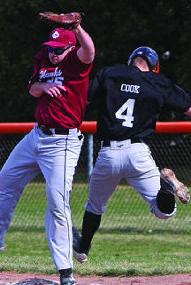 Harbor Beach's Colin Cook (4) is safe at first, after the ball got by Cass City first baseman Brock Thane in Game 1, Thursday in Harbor Beach.