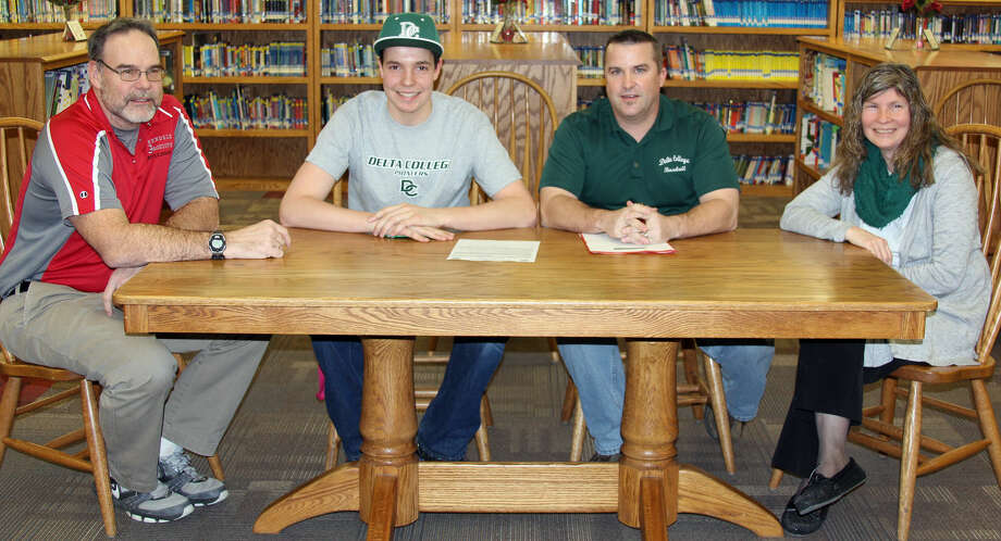 On Friday, Owendale-Gagetown standout Jacob Wright committed to play baseball for Delta College. He is joined by (from left) dad Brian Wright, Delta College coach Danny Smith and mom Rhonda Wright.