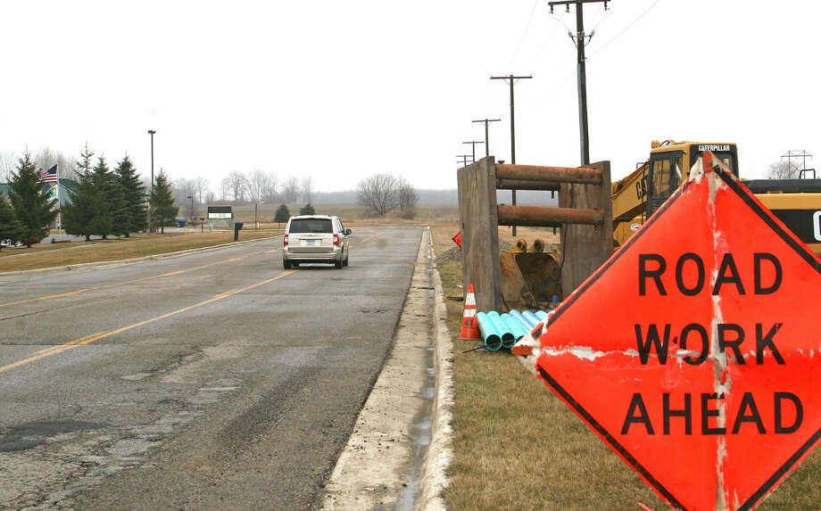 Local roadwork signs will be more common if voters decide we should improve our state roads. Photo: Tribune Photo