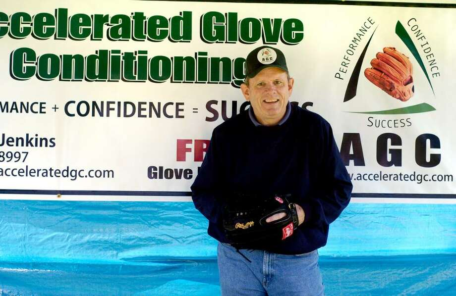 Mason Jenkins, founder of Accelerated Glove Conditioning, with glove and promotional material in Stamford, Conn. on Monday April 12, 2010. Photo: Dru Nadler / Stamford Advocate