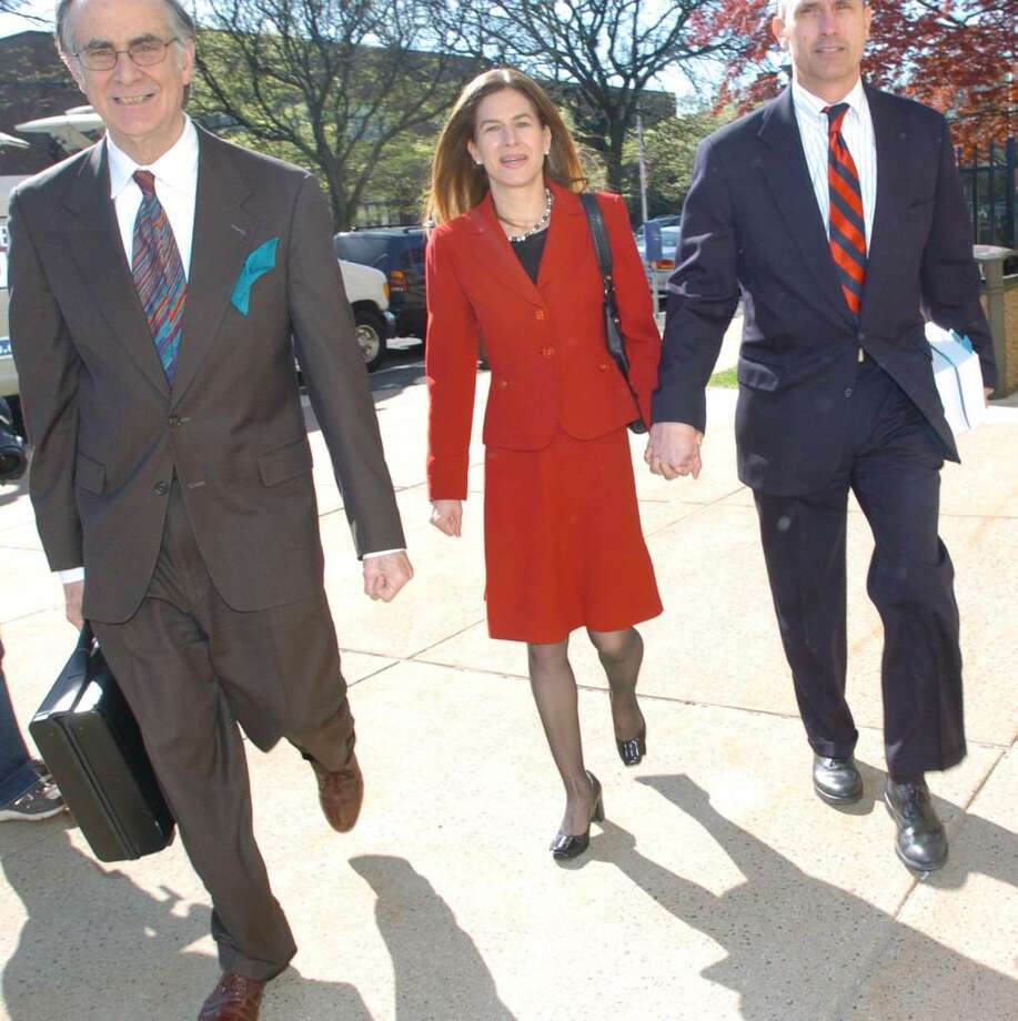 Secretary of the State Susan Bysiewicz, center, walks into Hartford Superior Court Wednesday, April, 14, 2010. Photo: Chris Ware / The News-Times