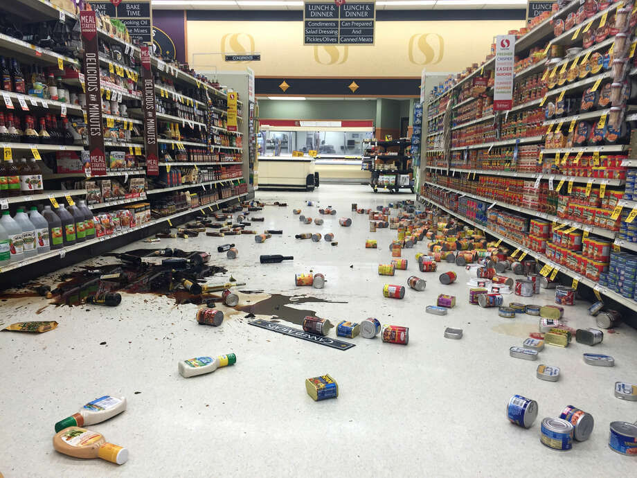 In this photo provided by Vincent Nusunginya, items fallen from the shelves litter the aisles inside a Safeway grocery store following a magnitude 7.1 earthquake on the Kenai Peninsula on Sunday Jan. 24, 2016, in south-central Alaska. The quake knocked items off shelves and walls in south-central Alaska and jolted the nerves of residents in this earthquake prone region, but there were no immediate reports of injuries. (Vincent Nusunginya via the AP) Photo: Vincent Nusunginya