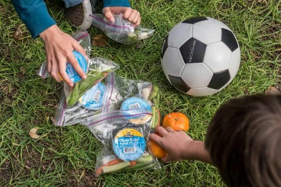 Make your own after-sports snack pack with olives, veggies, cheese and fruit.