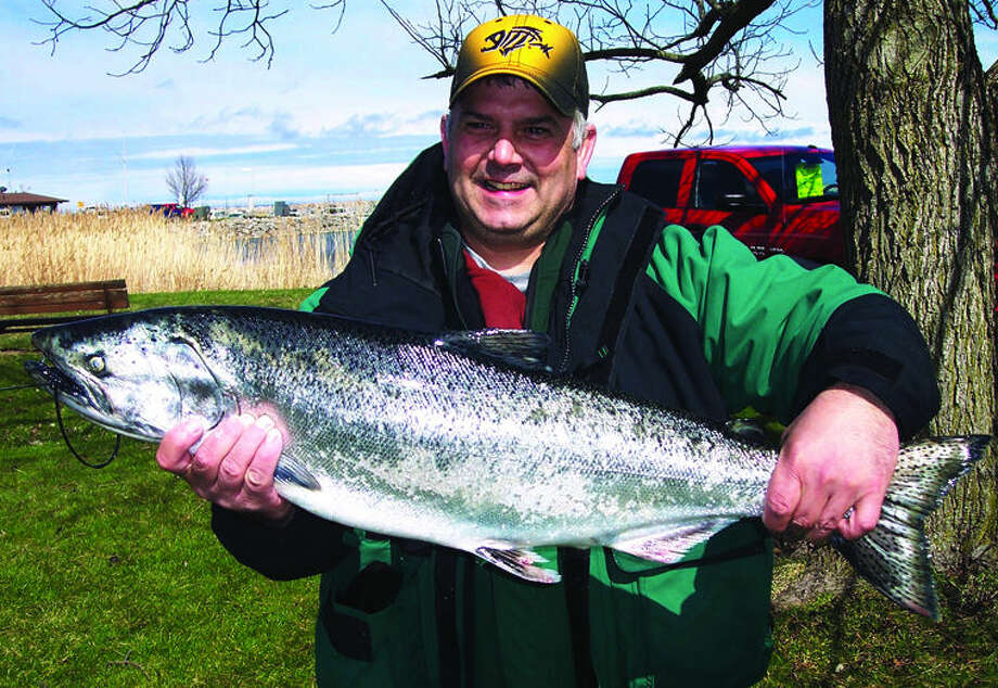 Darren Holz displays the largest King Salmon of the tournament. It netted him an additional $250. Rich Harp/For the Tribune