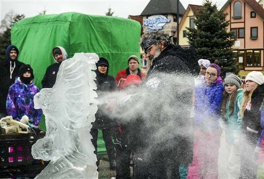 Master Ice Carver Jay Leahy, of Napoleon, Ohio, uses a rotary tool to cut the wings for a sculpture of an eagle before Zehnders' SnowFest in Frankenmuth, Mich. Snowfest opens Wednesday and runs through Monday in the Bavarian-themed community about 75 miles northwest of Detroit. (Jacob Hamilton/The Saginaw News via AP)