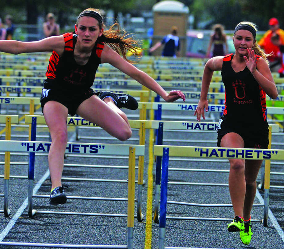 Ubly's Brigette Vogel leads teammate Samantha Pionk in the 100 hurdle semifinals during action at the Hatchet Track & Field Invitational, Friday in Bad Axe.