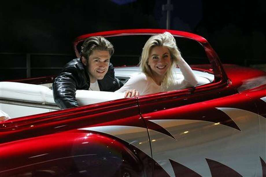 """In this 2016 photo provided by FOX, Aaron Tveit, left, and Julianne Hough rehearse for """"Grease: Live,"""" airing live Sunday, Jan. 31, 2016 (7:00-10:00 PM ET live/PT tape-delayed), on FOX. (Kevin Estrada/FOX via AP) Photo: Kevin Estrada"""