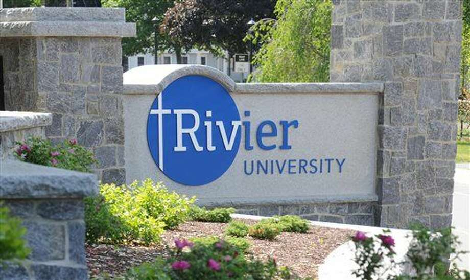 In this undated handout photo provided by Rivier University, the colleges' sign is seen at the entrance to the campus in Nashua, N.H. The small private university is promising students that they will get jobs within nine months of graduation. If not, Rivier University will pay the students' federally subsized student loans for up to a year, or enroll them in up to six master's degree courses for free. (Jodie Andruskevich/Rivier University via AP)