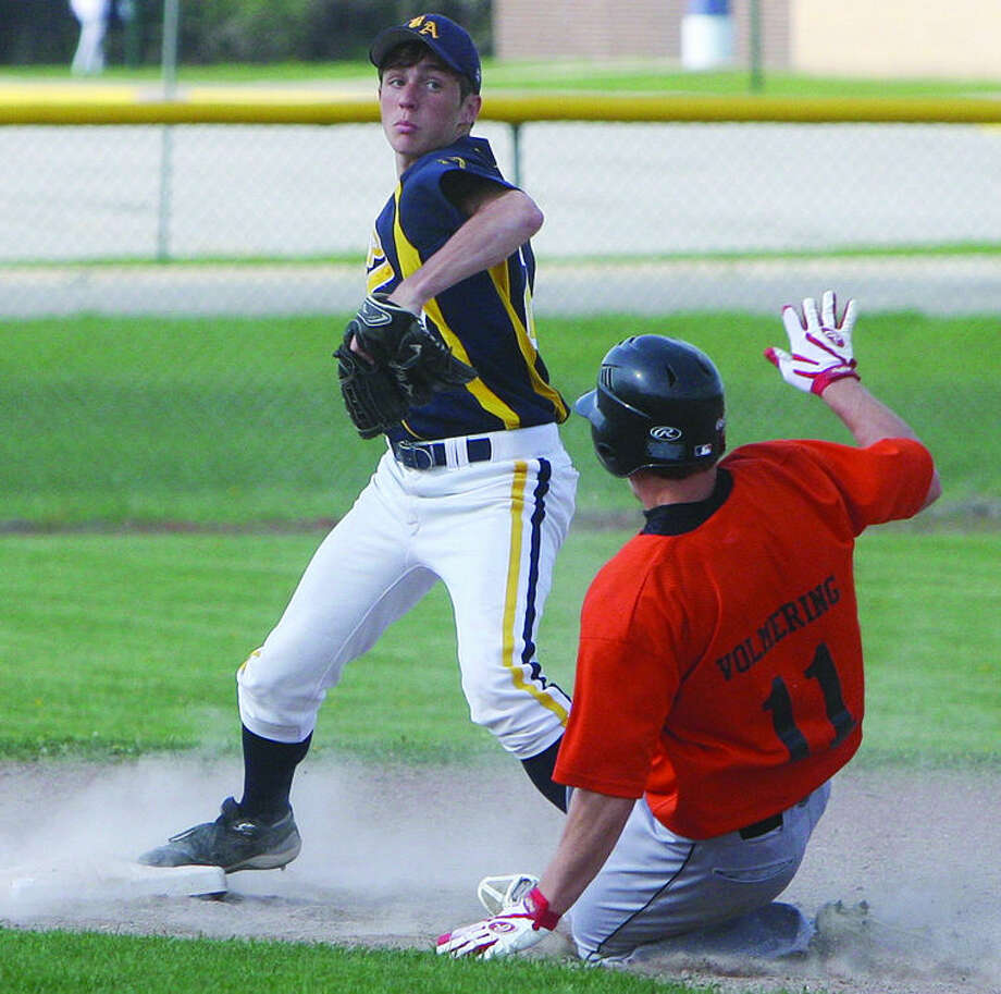 Bad Axe second baseman Tommy Morneau avoids Harbor Beach baserunner Brady Volmering (11) as he attempts to turn a double play in Game 1, Monday in Bad Axe.