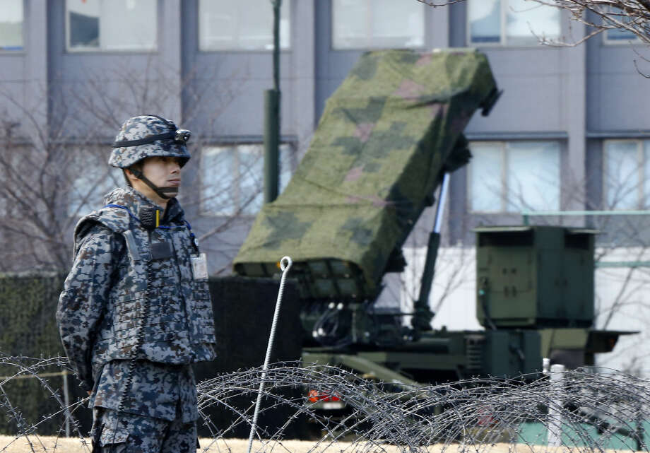 A Japan Self-Defense Force member stands by a PAC-3 Patriot missile unit deployed for North Korea's rocket launch at the Defense Ministry in Tokyo, Sunday, Jan. 31, 2016. Japan's Defense Ministry installed missile interceptors at their headquarters in central Tokyo on Friday amid signs that North Korea may be preparing to launch a rocket or missile. (AP Photo/Shizuo Kambayashi) Photo: Shizuo Kambayashi