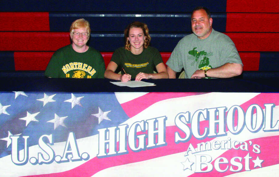 USA track and field standout Sarah Rievert is joined by her parents Denise and Brian Rievert as she signs her letter of intent to continue her career at Northern Michigan University, Monday at USA.