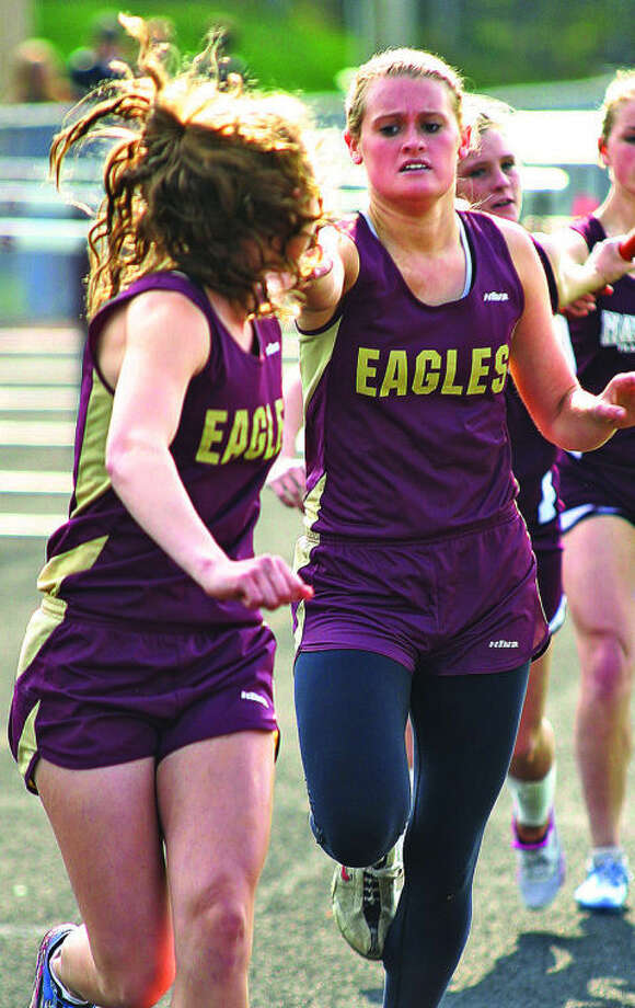 Photos courtesy of Tuscola County AdvertiserDeckerville's Liz Ridley hands off to teammate Kendra Colesa in the 3,200 relay, Tuesday, during the NCTL League Meet at Mayville.