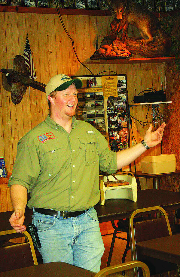 Wildlife biologist Jason Myers talks to local sportsmen about a conservation effort that could lead to a lot more pheasants in Huron County.  Photo: Rich Harp/For The Tribune