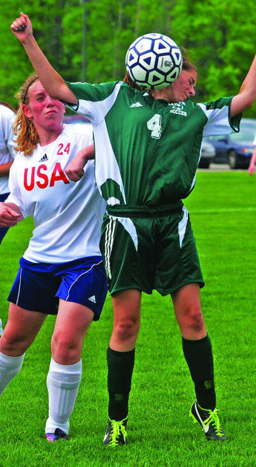EPBP's Shianne Nickerson (4) plays the ball in front of USA's Haley Ewald (24) during the first half of the Patriots' 4-1 Division 4 district soccer quarterfinal win, Tuesday at USA.
