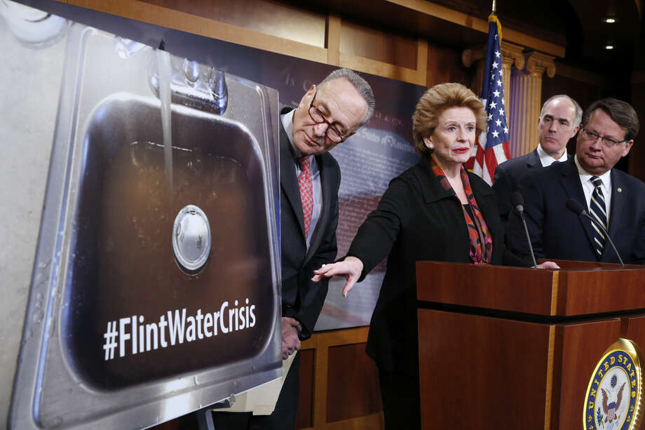 Sen. Debbie Stabenow, D-Mich., second from left, accompanied by, from left, Sen. Charles Schumer, D-N.Y., Sen. Bob Casey, D-Pa., and Sen. Gary Peters, D-Mich., discusses proposed legislation to help Flint, Mich. with their current water crisis, Thursday, Jan. 28, 2016, during a news conference on Capitol Hill in Washington. (AP Photo/Alex Brandon) Photo: Alex Brandon